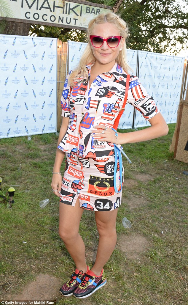 Looking good: Pixie was all smiles in her adorable printed dress and retro sunglasses
