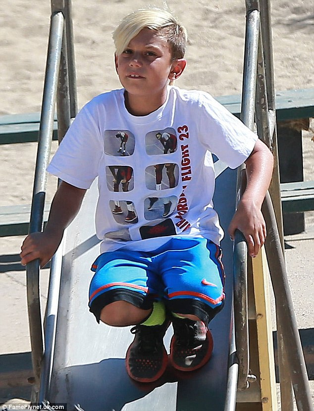 Never too old! Kingston was spotted on the slide at the park
