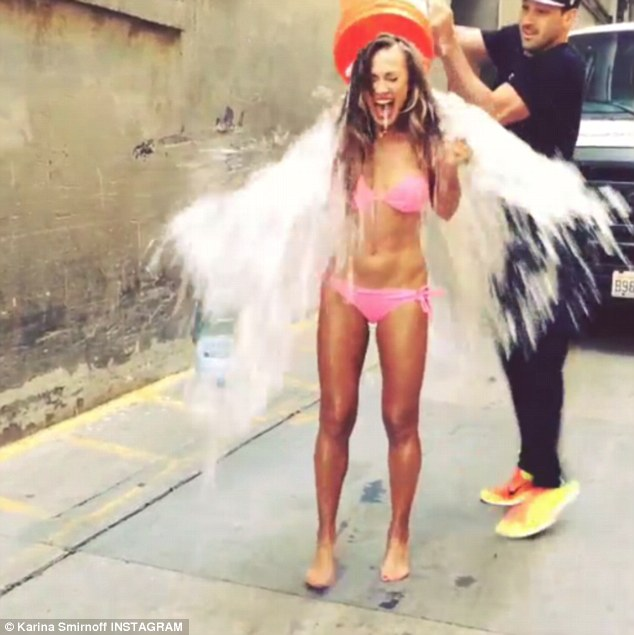 Pretty in pink: The 36-year-old Dancing With The Stars professional wore a neon bikini as she took the full brunt of the cool water