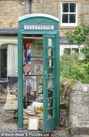 John Hay, 67, has decked out the former British Telecom box with First World War memorabilia