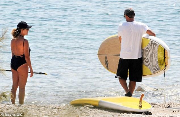 Greek odyssey: Tom Hanks and Rita Wilson go paddle boarding on the Greek island of Antiparos