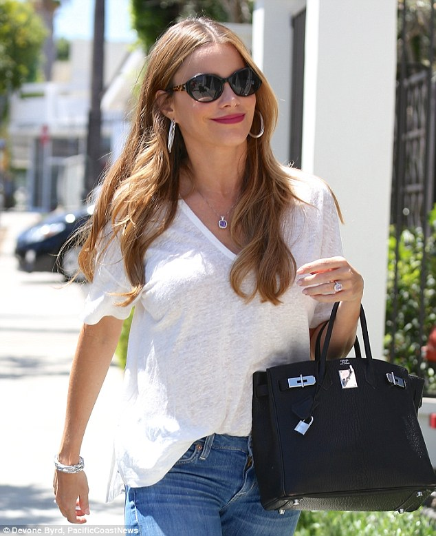 Something to tell us? Sofia Vergara stepped out for lunch in LA on Monday with a wide grin on her face and a HUGE sparking diamond ring on THAT finger, sparking speculation beau Joe Manganiello had popped the question after two months together