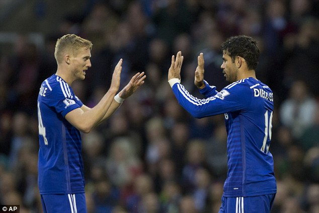 Goalscorers: Andre Schurrle (left) and Diego Costa (right) both managed to get themselves on the scoresheet