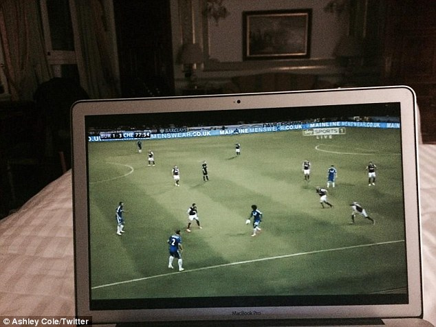 Chelsea fan: Ashley Cole shows he still has a soft spot for his former side by watching the Blues on his laptop
