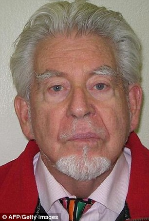 'Willy Wonka': Rolf Harris has been handing out Mars Bars to inmates who play dominoes with him