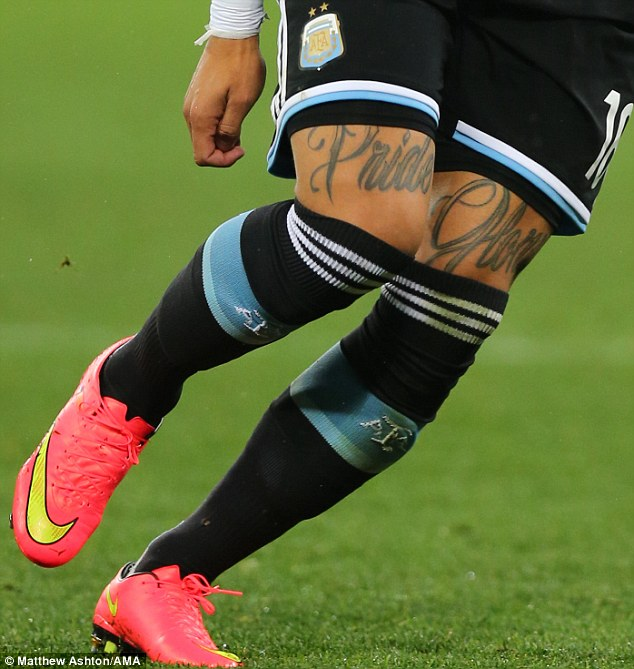 On show: 'Pride' is inked on the right leg of Manchester United defender Rojo, with 'Glory' on the other