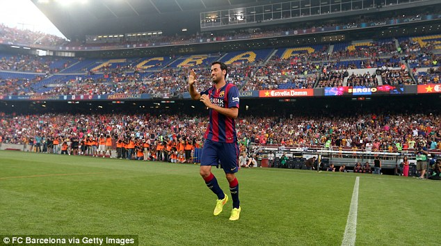 Favourite: Song has found it almost impossible to take Sergio Busquets' place in Barca's starting XI