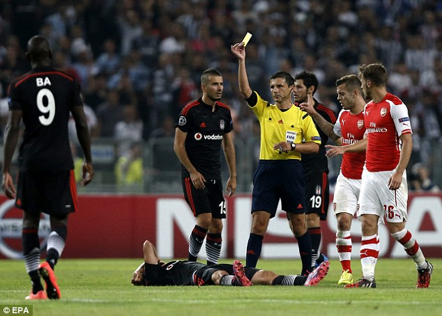 In the spotlight: Wenger was unhappy by the display of refereeMilorad Mazic (centre)