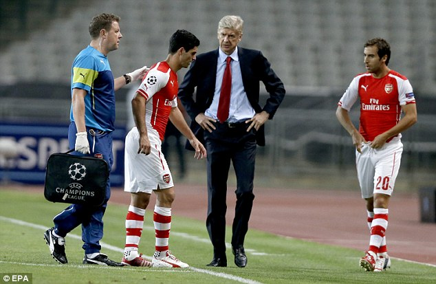 Sour note: Arsenal captain Mikel Arteta (second left) had to be replaced due to injury