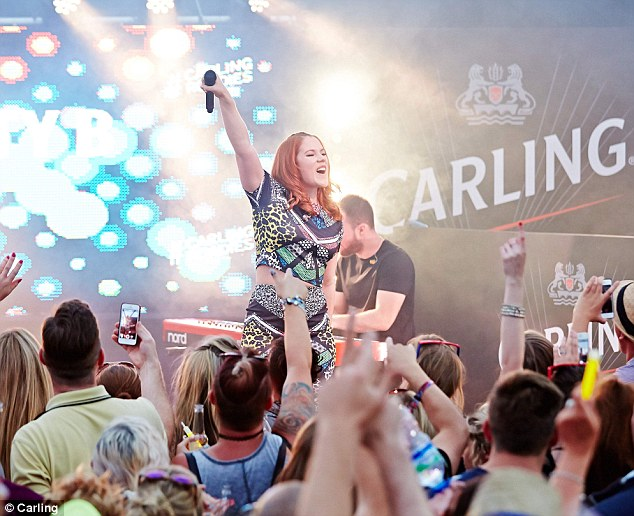 Rocking out: Katy B also delighted the crowd at the Carling Roadies Tent, in homage to the festival's official beer and cider partner