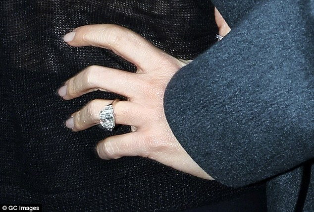 'It is perfection': The engagement ring Sofia was given by former fiancé Nick was an 8-carat sparkler by New York jeweller Two By London featuring a 7-carat cushion-cut centre diamond flanked by two slightly smaller diamonds on either side