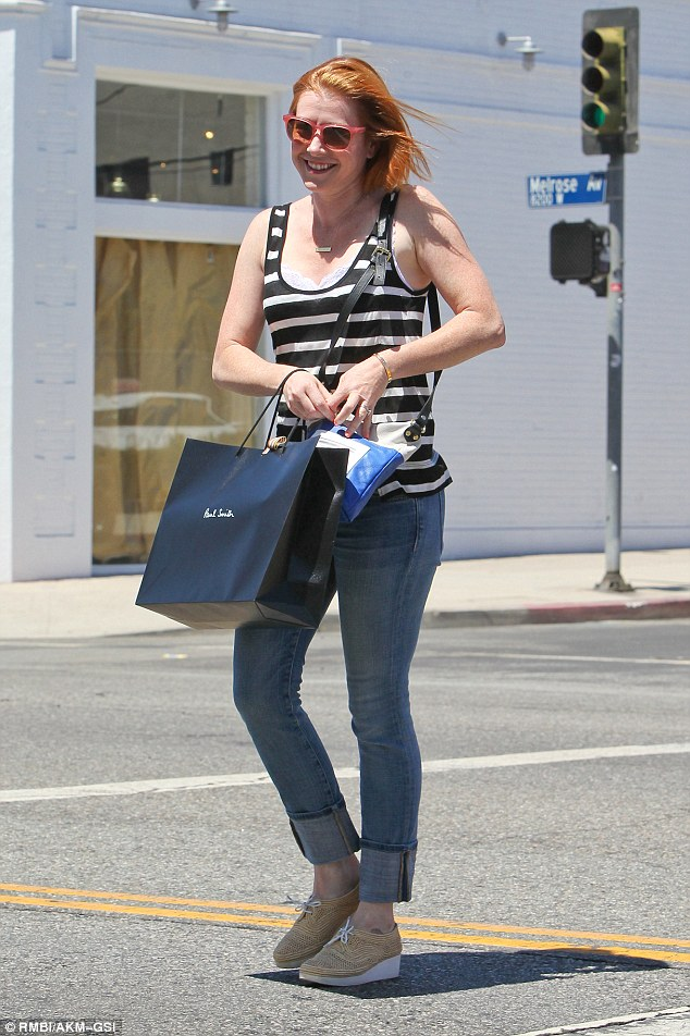 Successful shopping trip: Actress Alyson Hannigan visited retail store Paul Smith in Los Angeles on Monday