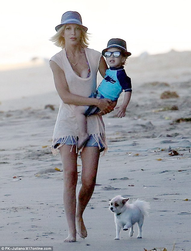 Mama's boy! Tori Spelling and her youngest son Finn rocked matching fedoras as they hit the beach with the rest of the family in Malibu on Monday