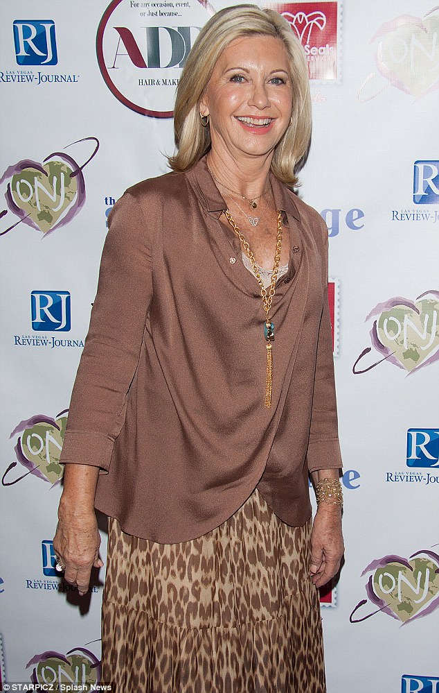 Attention to detail: Olivia sported a silky brown blouse with flowing sleeves and a slinky neckline