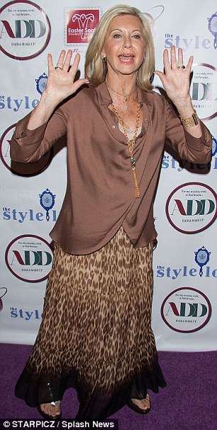 Brown colour scheme: Olivia sported a silky brown blouse teamed with a flowing printed leopard print skirt