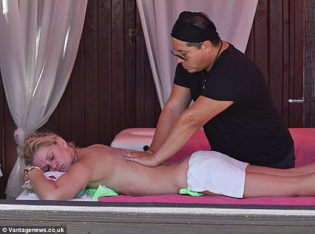Unwind: Eventually Danniella seemed to close her eyes and relax as the masseuse worked on her back