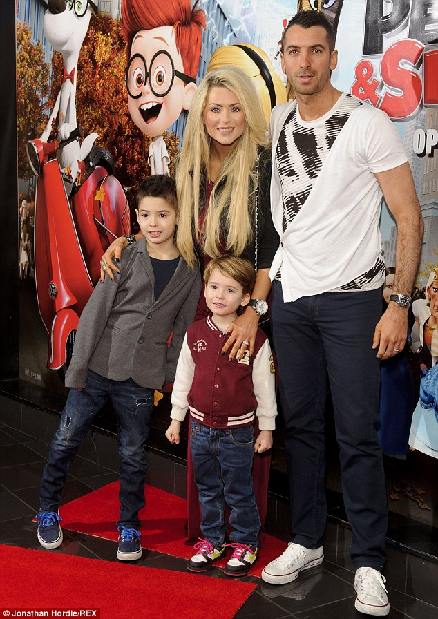 Family ties: The couple pictured in February with their sons Rocky and Striker