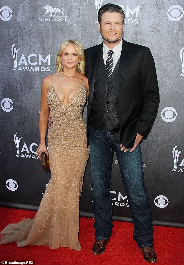 Slimmed down: Over the last year, the singer - seen with husband Blake Shelton at the CMA's April 6 - lost more than 25 pounds which she says came from healthy eating along with cardio and circuit training