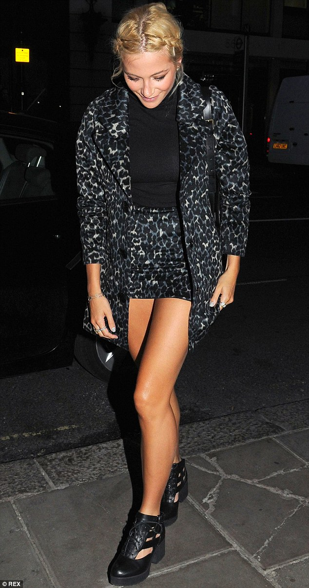 Leggy display: The singer teamed a leopard print mini skirt with a coordinating blazer for her girls' night out