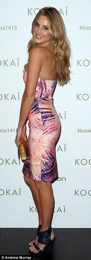 Standing out: Her ravishing Kookai dress featured a mixture of purple and pink leaf designs, and was quite eyecatching amongs the mostly monochrome outfits worn to the show