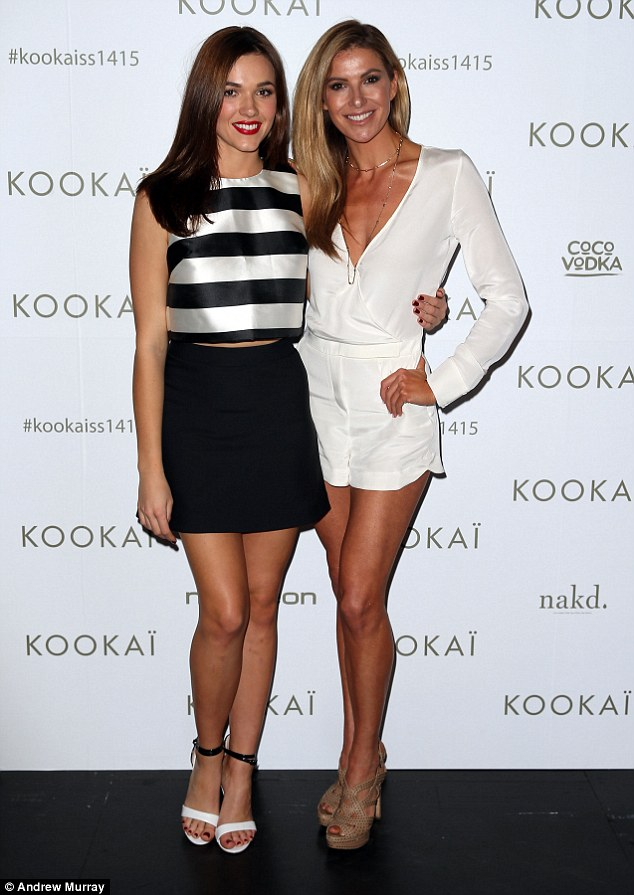Gal pals! She posed happily with television presenter Laura Csortan, who wore a long sleeved white jumpsuit