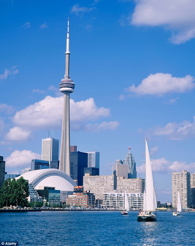 The CN Tower in Toronto:Canada is listed as the 3rd top destination people dream of travelling to