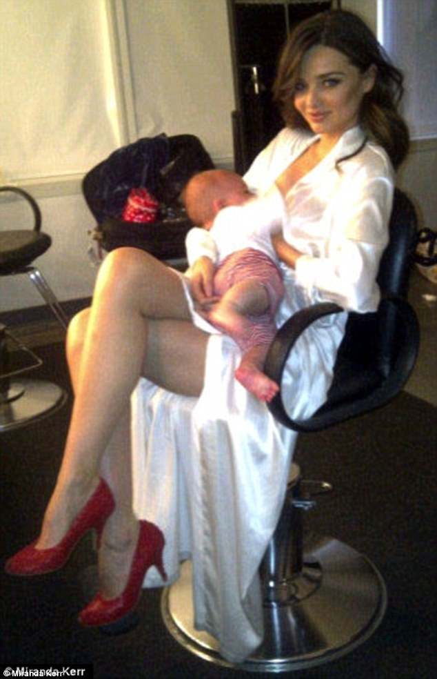 Glam mum: Miranda Kerr uploaded this snap of her breastfeeding while in the make-up chair to Twitter in 2011