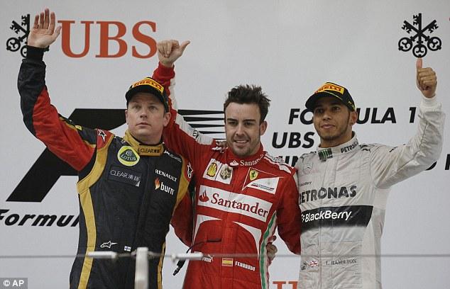 Happier times:Raikkonen (left) and Alonso (centre) celebrate a podium finish in the 2013 Chinese Grand Prix