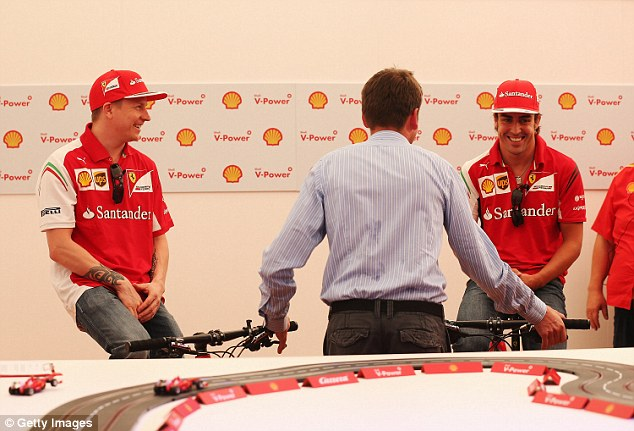 Taking instructions: The pair receive a briefing before the Melbourne Grand Prix