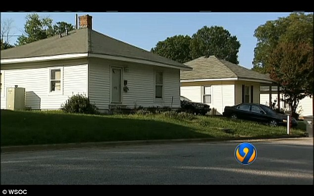 On his own: The toddler was spotted wandering naked in the yard of his parents' Landis, North Carolina, home without any supervision