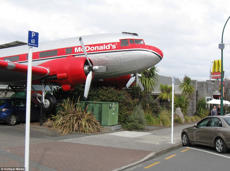 It's a McTakeoff: The 20-seater McDonald's housed in a vintage luxury DC-3 plane with red and silver interior seats