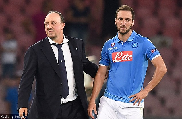Down: Napoli head coach Rafael Benitez (left) looks to console his striker after the game