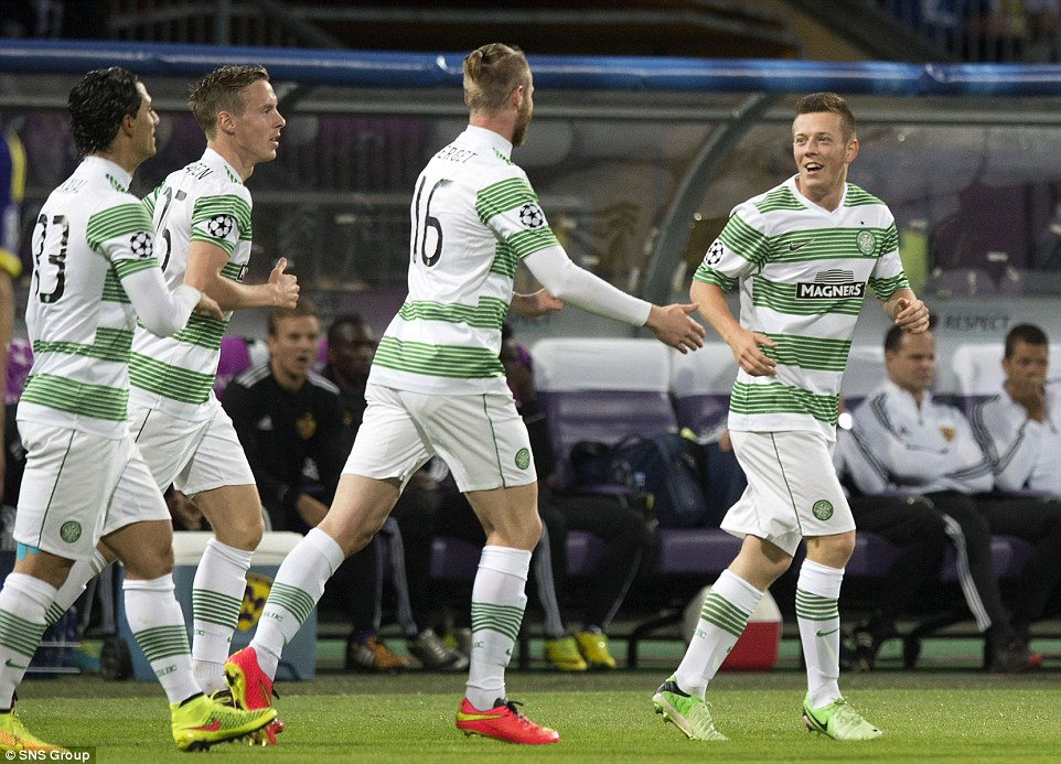 All smiles: Celtic players (from left to right) Beram Kyal, Stefan Johansen and Jo Inge Berget celebrate with goalscorer McGregor (far right)