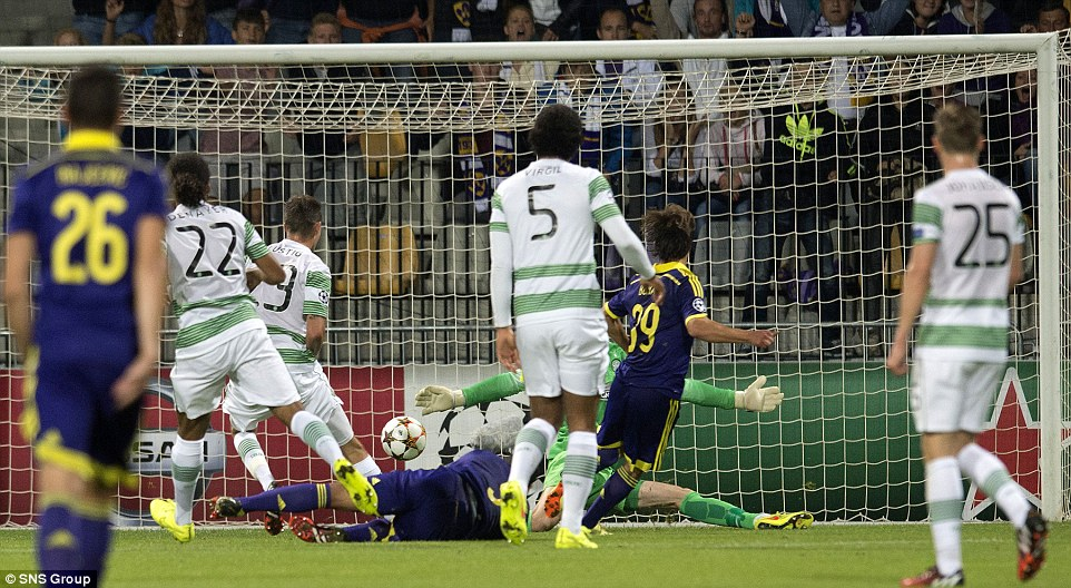 All square: Maribor's Damian Bohar (second from right) tucks the ball beyond Celtic goalkeeper Craig Gordon to get his side back on level terms