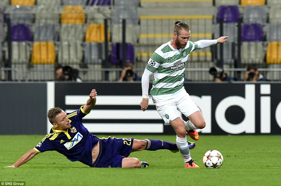 Sliding in: Celtic midfielder Jo Inge Berget (right) evades a strong tackle from Maribor's Dare Vrsic (left)