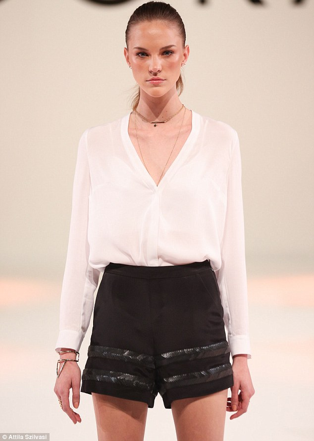 Black and white: Model Nicole Pollard stunned as she strutted down the runway