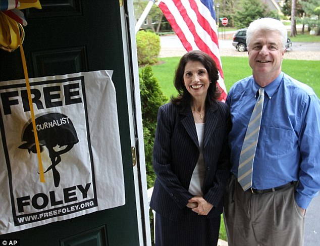Two years of hope: James Foley's parents, John and Diane Foley, pose outside their house where a yellow ribbon hangs in an image taken after they decided to publicize his disappearance