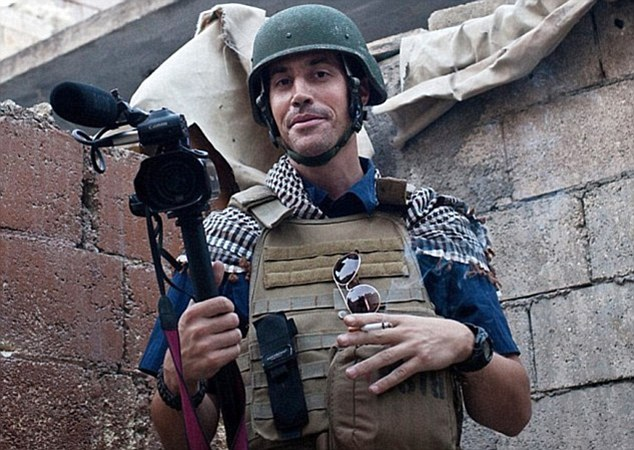 At work: James Wright Foley, had been missing since November 2012, after being taken hostage at gunpoint by militants from the pre-ISIS group Jabhat al Nusra while reporting from Taftanaz, northern Syria