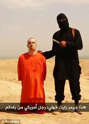 Addressing the camera: James Wright Foley's executioner holds his knife and unfurls his reasons for taking the American journalists life before he beheads him