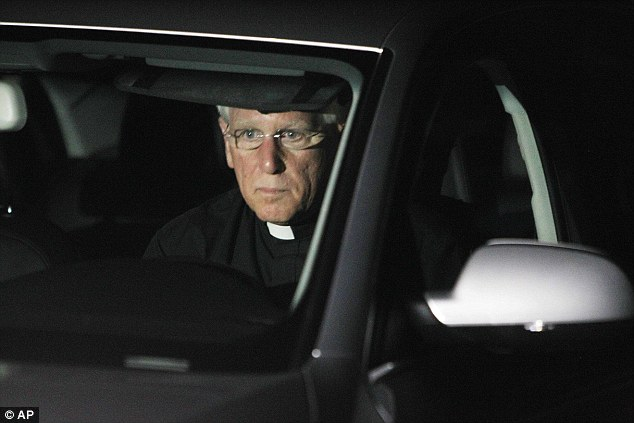 Support: Rev. Paul Gousse from Our Lady of the Holy Rosary leaves after meeting with the family of American freelance journalist James Foley in Rochester, New Hampshire, Tuesday night