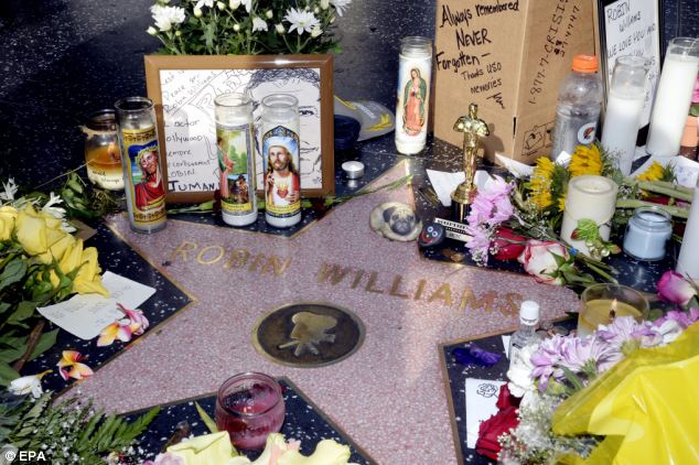 Flowers and tributes placed on the Hollywood Walk of Fame star for late actor Robin Williams in Hollywood, California