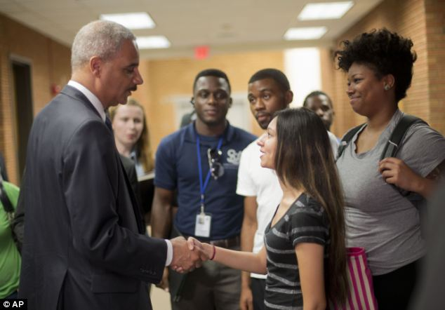 Bri Ehsan, 25 (center right) was one of a handful of community college students who joined Holder for a brief chat and a photo-op