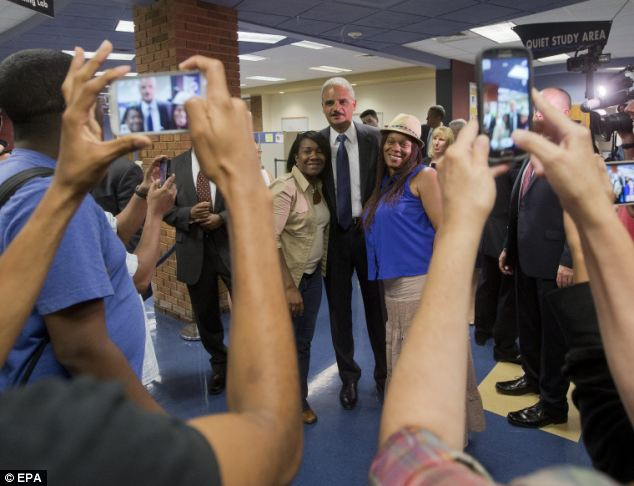 Attorney General Eric Holder met with students at St. Louis Community College Florissant Valley, in Ferguson, Missouri, on Wednesday. He is in the St. Louis area to oversee the federal government's investigation into the shooting of 18-year-old Michael Brown by a police officer