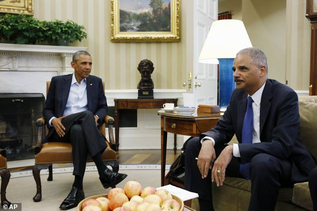 Attorney General Eric Holder met last week with President Obama in the Oval Office of the White House to discuss the growing unrest in Missouri sparked by the police shooting of a black teen robbery suspect