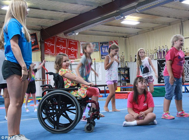 Team Inspire: The new cheer squad, formed for children with special needs at the Gym Tyler in Texas, watch on as another squad performs