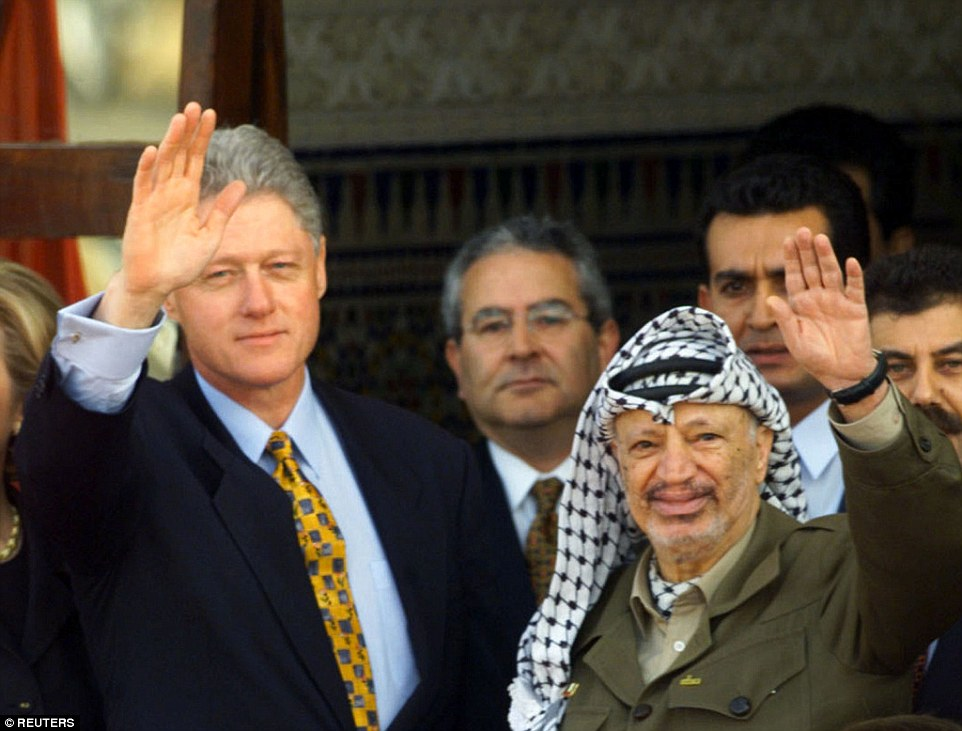 Grand opening: President Bill Clinton and Palestinian President Yasser Arafat both wave at the Gaza International Airport in December 1998