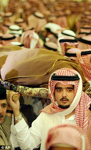 The Prince was the favoured son of the late King Fahd of Saudi Arabia, who died in 2005, but is best known for his high-living lifestyle. He is pictured carrying the shrouded body of the king