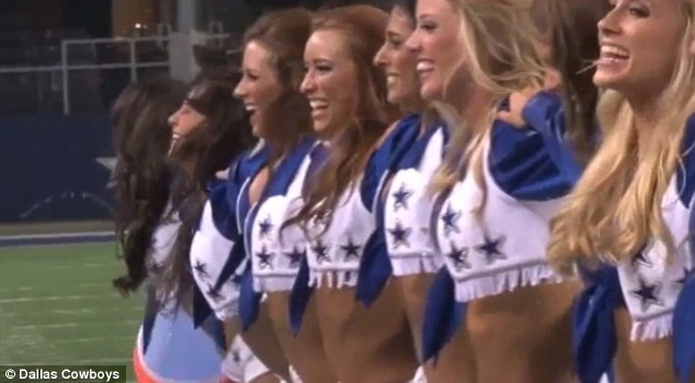 Wet: The Dallas Cowboys cheerleaders lined up before being soaked with freezing water on the pitc