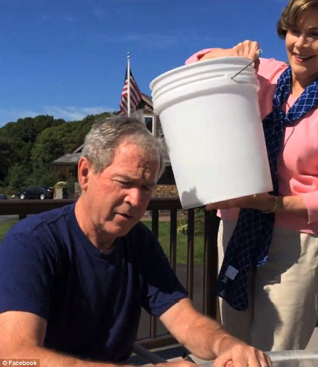 Chilly challenge: Before the former president could get away with simply buying out of the chilly challenge, his wife Laura sneaked up and douse him in the required fashion