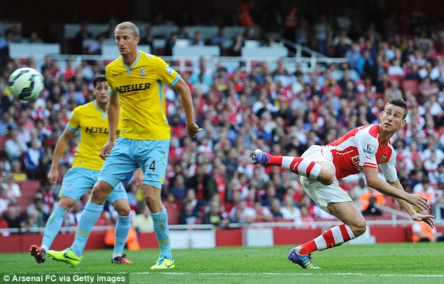 Watching on: Hangeland can only look as Arsenal defender Laurent Koscielny (right) equalises at the Emirates